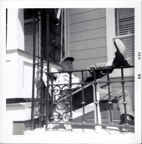 Earl Elliot Strausser relaxing on his Lynn Street porch.